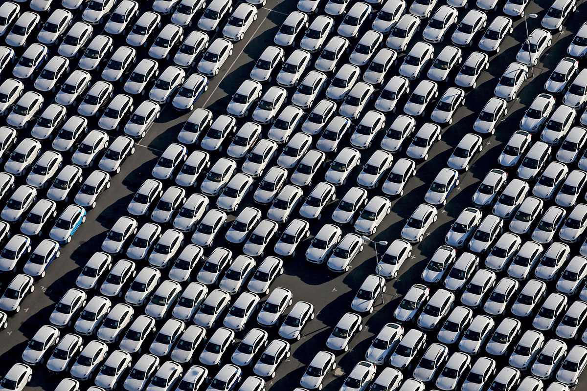 TOPSHOTS New Porsche cars are parked at the grounds of the Porsche plant in Leipzig, eastern Germany, on November 3, 2015. The US Environmental Protection Agency said late Monday, November 2, 2015, it had discovered that various six-cylinder 3.0 litre diesel VW Touareg, Porsche Cayenne and Audis were also rigged with a software which skews the results of pollution tests.     AFP PHOTO / DPA / JAN WOITAS   +++   GERMANY OUT   +++