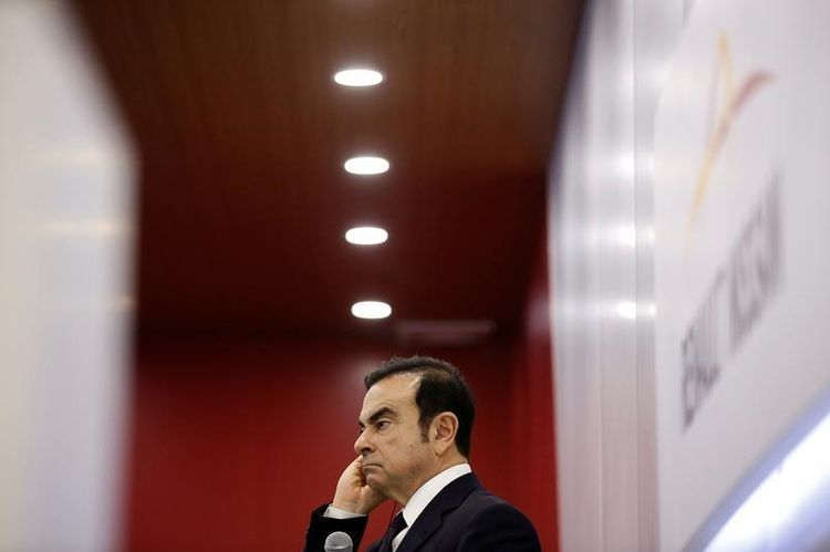 872830-carlos-ghosn-chairman-and-ceo-of-the-renault-nissan-alliance-attends-a-round-table-discussion-during